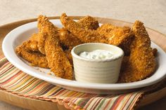 These Crispy Chicken Fingers are a restaurant favorite you can make at home—easily—with boneless chicken breasts and pantry ingredients.
