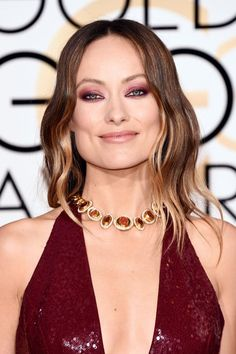 The Best Beauty Looks From The Golden Globes #refinery29  http://www.refinery29.com/2016/01/100905/golden-globes-2016-best-hair-makeup#slide-14  Instead of reaching for typical grey and black eyeshadows to create Olivia Wilde's sultry smoky eye, makeup artist Jo Baker used burgundy shades and black liner to bring out the actress' blue irises....