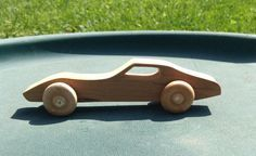 All natural, unfinished wooden toy car, Cherry 1970s Chevrolet Corvette Stingray, handmade on a scroll saw