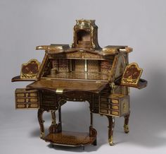 This desk has numerous secret compartments and drawers and even includes a fold-out prie-dieu. It was made for Johann Philipp von Walderdorff, archbishop and elector of Trier, and is decorated at the top with his portrait and heraldic arms. The desk is the most expensive showpiece ever made by Abraham Roentgen, the leading cabinetmaker in Germany in his day. Abraham Roentgen, ca. 1758 - ca. 1760.