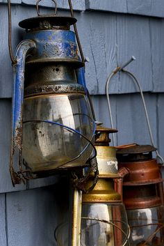 Lanterns I love rustic old fashioned lanterns. I'd love to have a railroad styled one. Old Lanterns, Vintage Lanterns, Rustic Lanterns, Deco Marine, Kerosene Lamp, Lantern Lamp, Oil Lamps, Country Decor, Country Blue