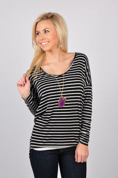 This is just the Perfect Stripes Top! The mainly black top with white stripes pairs perfectly with those white skinny jeans or even a pair of leggings! This is a versatile top that can be dressed up or down! Pair with one of easy accessories and you're all set for the date night out! This top is made out of 94% Rayon and 6% Spandex. Hand-wash cold, hang dry.