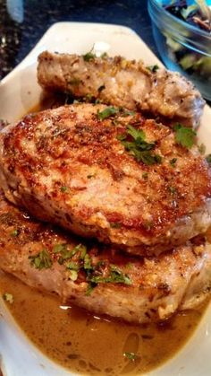 Sauteed Pork Chops with Lemon Garlic Sauce.  These took a lot longer to cook (I used 1-1/4 inch thick chops) so I finished them in a 375 oven before I made the sauce.  This was a good, basic recipe.  Quick for a weeknight with really good flavor. by Andrea E.