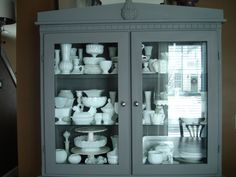 Milk Glass Collection! I also like the cabinet color...maybe repaint mine.