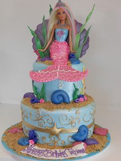 Mermaid Barbie Cake (2164)...love the gold starfish & swirl accents and shell barbie backdrop!