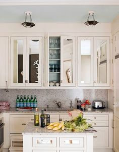 Haven't seen mirrored cabinets in the kitchen...I like it.