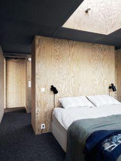 Bedroom in a striking Swedish villa built from solid wood/ Photo - Jonas Ingerstedt.