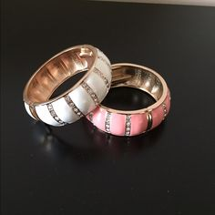 White and pink bangles with gold accents Both bangles have a hinge opening Jewelry Bracelets