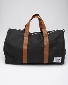 $80 Novel    Herschel Supply Co.    The perfect duffel bag with synthetic leather strap detailing, a separate shoe compartment and padded shoulder strap. Fully lined with Herschel's Custom Fabric. Removable shoulder strap. Forty five liter capacity. Waterproof zipper detail.    11˝ height   23˝ width  10.5˝ depth