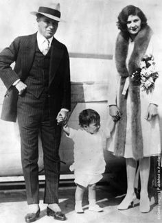 British comic actor and film director Charlie Chaplin (1889–1977) with his wife Lita Grey  and son Charles Spencer Jnr on board the SS City of Los Angeles. (Photo by Topical Press Agency/Getty Images). 1926