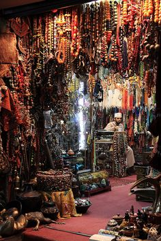 oh my gosh, I MUST visit some day! stall holder in Mutrah Muscat, Oman by Lachian Towart 2010
