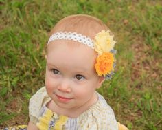 Triple chiffon flowers in light yellow, sun yellow and gray on an ivory one-size lace band. So pretty for summer and the different variations of yellow will match almot any yellow outfit. www.etsy.com/shop/bellagraziadesigns