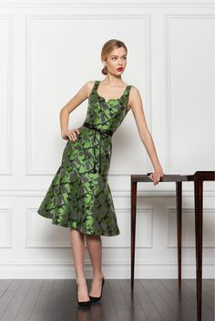 My favorite designer Carolina Herrera created a fun dress in this lovely green jewel.