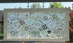 Lace. Reclaimed window with textured pieces such as trinket boxes, candle holders, saucers, and glass gems.