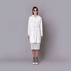 Cocoon Spring - Summer 2015 / Muss collection / Creamy white jacket with hood in newspapper print.