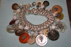 Vintage Shell Button bracelet Chainmaille Charm Bracelet with Vintage shell buttons Silvertone and wire wrapping