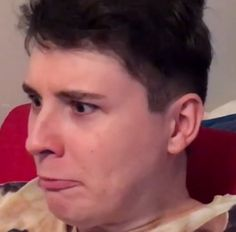 the face of a broken man (Phil tricking Dan with  hot chilly gummy bears, video on lessamazingphil)