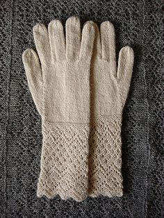 These dainty, old-fashioned gloves feature an elaborate lace edge that's worked sideways in garter stitch. The strip of knitting is grafted into a ring to form the cuff, and the remainder of the glove is worked in the round. The soft alpaca lace yarn held double makes a thin but warm fabric, perfect for dress gloves.