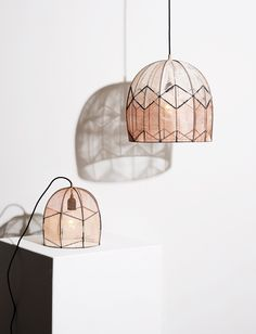 """Denmark based designer Alexandra Raben weaves steel frame structures with elaborate networks of threads to create her """"Intricate"""" lamps"""