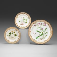 """A SET OF SIX ROYAL COPENHAGEN """"FLORA DANICA"""" DISHES AND A SERVING DISH, DENMARK, 20TH CENTURY."""