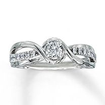 10K White Gold 1/3 Carat t.w. Diamond Engagement Ring I like the design of this one!