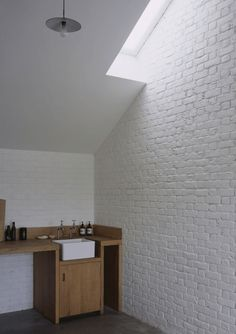 Inspirational images and photos of , Small Space Living : Remodelista Small Space Living, Small Spaces, White Brick Walls, White Bricks, Small Apartment Design, Roof Light, Pierre Jeanneret, Minimalist Kitchen, Stables