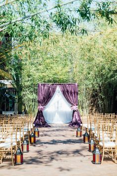 Outdoor Wedding Ceremony at St Pete Wedding Venue NOVA 535 with Purple Linen Flocked Archway and Gold Chaivari Chairs | St. Petersburg Wedding Chair Rentals Signature Event Rentals | Wedding Planner Exquisite Events