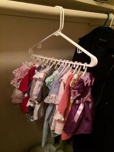 excellent idea for hanging doll clothes from thedollstation