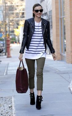 Has anyone ever looked chicer running errands? Miranda Kerr is sporting a Céline tote ($1900), Balenciaga biker jacket ($2514), and a sweater by The Row ($1575). No word on how many years it would take me to afford the pants.