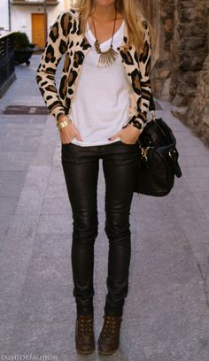 wild print - I love this leopard print sweater and leather pants look . . .I wish I could wear this out.