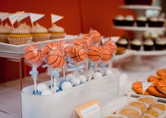 Basketball cake pops: use a mini ice cream scoop and insert stick. Dip in orange colored white chocolate melted in a crockpot with solid Crisco. When cooled add black stripes.