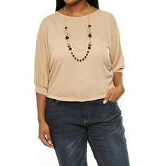 Beautiful crochet top NWT Features three quarter lenght cuffed sleeves,a round neck,and a detachable necklace with faux jewels and tiered  chains,the material is soft and has a crochet backand a crossover back hem.true to size. Tops
