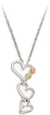 Landstrom's Dangling Heart Necklace Crafted by one of the leading jewelers specializing in Black Hills gold, this pendant features three tiers of hearts made of brilliantly cast sterling silver. The topmost heart is adorned with leaves made of genuine Black Hill's 12-kt. gold.