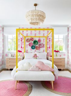 Decorative baskets hang from a wall cover in pink pineapple wallpaper over a yellow canopy bed accented with white and pink bedding. Pink Bedding Set, Girls Bedding Sets, Bedroom Sets, Bedroom Decor, Girl Bedding, Kid Bedrooms, Preppy Bedding, Preppy Bedroom, 1930s Bedroom