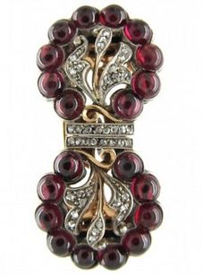 Cabochon Garnet Diamond Art Deco Double Clip Brooch Art Deco (1920-1935) A well designed brooch which comes apart to form two clips which can be worn on either side of a neck or lapel on a dress. It is set with small diamonds and cabochon garnets and is gold and platinum. Garnets weigh approx 0.30 cts each giving an approximate total carat weight of 3 carats Date Origin	Art Deco (1920-1935)