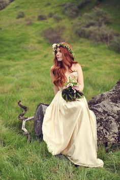 Redheaded bride in a beaded gold gown from Deborah Lindquist