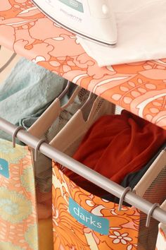 Jump-start+laundry+day+by+streamlining+your+sorting+ritual.+A+three-bag+laundry+sorter+encourages+organization+as+a+daily+routine.+The+open+design+with+easy-to-read+labels+helps+the+whole+family+see+where+to+place+items,+saving+you+time+sorting+clothes+on+washday.+Small-space+solution:+Opt+for+laundry+bags+that+can+hang+from+over-the-door+hooks+rather+than+hampers+that+take+up+floor+or+shelf+space.