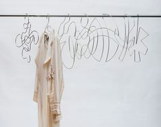XYZ Integrated Architecture have designed 'Piece Unique', a collection of artistic wire clothes hangers. Modern Clothes Hangers, Hanging Clothes, Girls Dressing Room, Dressing Rooms, Wire Coat Hangers, Artistic Wire, Clothing Hacks, Unique Outfits, Retail Design
