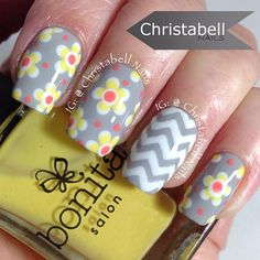 Spring flowers and chevrons! Come on Spring show yourself!!!!! I Love using @teismom's nail vinyls she really converted me because I never liked tape manis before. I just restocked too and have new shapes to try out. Her vinyls are AMAZING! YouTube tutorial link in profile #notd #nailart #instanails Polishes used: Maybelline Color Show Audacious Asphalt, @bonitacolors Creaaamson (yellow) and Honey Me (coral), Motives Cosmetics Wedding Dress (white), and topped with Glossy Glam by ...