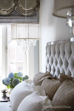 South Shore Decorating Blog....hanging crystal chandelier side lights with tufted headboard