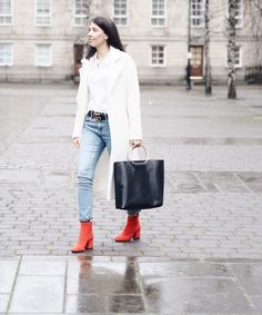 Red suede ankle boots, ring bag and white wool coat