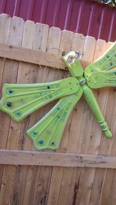 Table leg fan blade dragonfly garden fence art decoration. Antique door knob eyes
