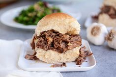 Slow Cooker Roasted Garlic Beef Sandwiches-toast buns, top with swiss, and serve with hot mustard (Chinese style)!