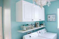 Laundry room re-do.  Cute idea to add a bright color for a laundry area.  I only have a laundry closet but I could still add bright colors and cabinets.