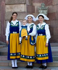 The ladies of the Swedish Royal Family dressed in traditional folk costume for the celebration of National Day on June 6, 2013 in Stockholm, Sweden. HRH Queen Silvja and HRH Crown Princess Victoria are wearing the white hats customary of married woman; Princess Madeleine is not as she was not yet married at the time.