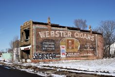 Webster Cigars.  Great ghost sign until some bozo tagged it!