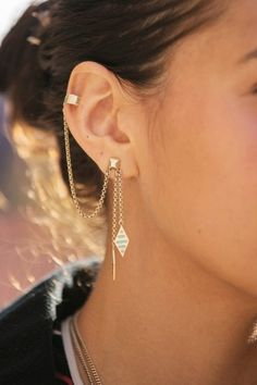 Karen Gallo's ear chain has us seriously considering a trip to the piercing salon.
