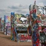 A closeup of the Cadillac Ranch in Amarillo, Texas.  Located off the I-40 between exits 60 and 62. If you go, be sure to take your spray paint to leave your mark.