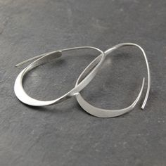 Silver Curl Hoop Earrings - A unique take on the traditional hoop, these Silver Curl Hoop Earrings will definitely get noticed. Gradually tapered, these hoops look wonderful and are easy to wear, too! #Otisjaxon #Jewellery #MothersDay #Present
