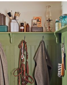 A variety of collectibles—from blue Ball jars to tackle boxes—line the mudroom's ledge,